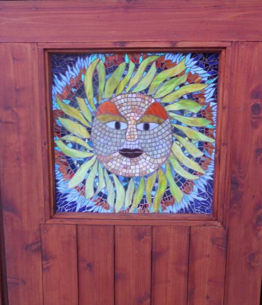 Sun God installed in door