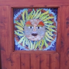 Sun God installed in door