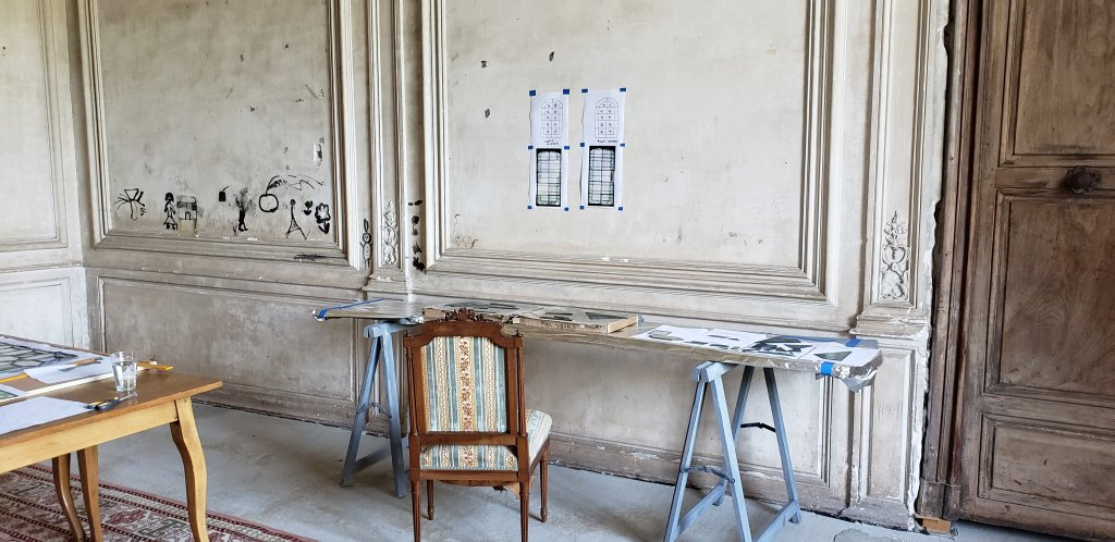 The gluing station in the Atelier. The graffiti on the left is from children.  The Chateau was used as a children's camp during the 1960's.