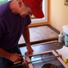 Carpenter framing the completed panel
